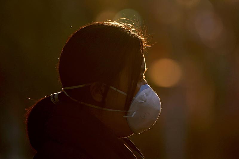 A woman wearing a mask is seen on a street in Shanghai, China, as the country is hit by an outbreak of a new coronavirus, February 1, 2020. Photo: Reuters