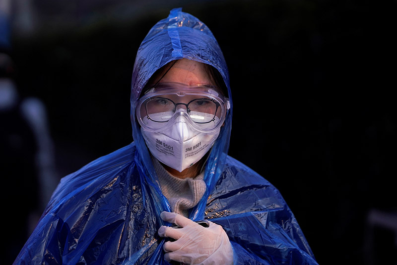 A passenger wearing a mask walks at the Shanghai railway station in China, as the country is hit by an outbreak of the novel coronavirus, February 9, 2020. Photo: Reuters
