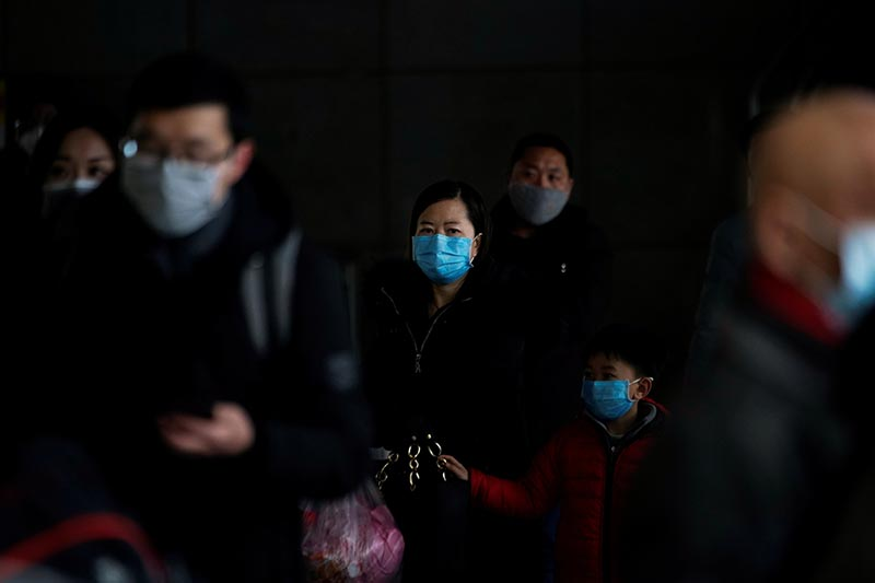 Passengers wearing masks walk outside the Shanghai railway station in Shanghai, China, as the country is hit by an outbreak of the new coronavirus, February 8, 2020. Photo: Reuters