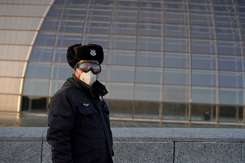 A security guard wearing goggles and a face mask is seen near the National Centre for the Performing Arts, following an outbreak of the novel coronavirus in the country, in Beijing, China February 22, 2020. Photo: Reuters
