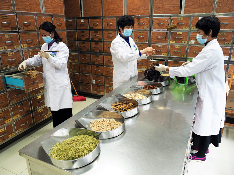 Medical workers prepare traditional Chinese medicine (TCM) at a TCM hospital as the country is hit by an outbreak of the new coronavirus, in Binzhou, Shandong province, China February 5, 2020. cnsphoto via Reuters