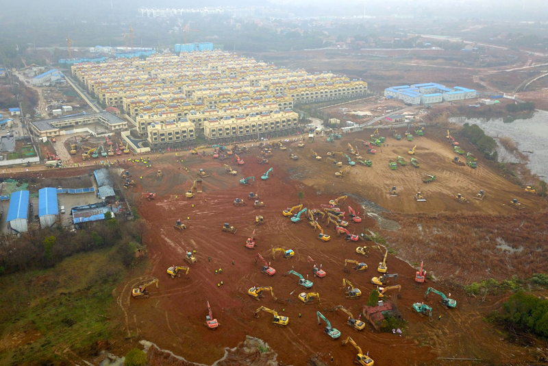 Excavators and bulldozers are seen at the construction site where the new hospital is being built to treat patients of a new coronavirus, following the outbreak and the city's lockdown, on the outskirts of Wuhan, China January 24, 2020. Photo: cnsphoto via Reuters