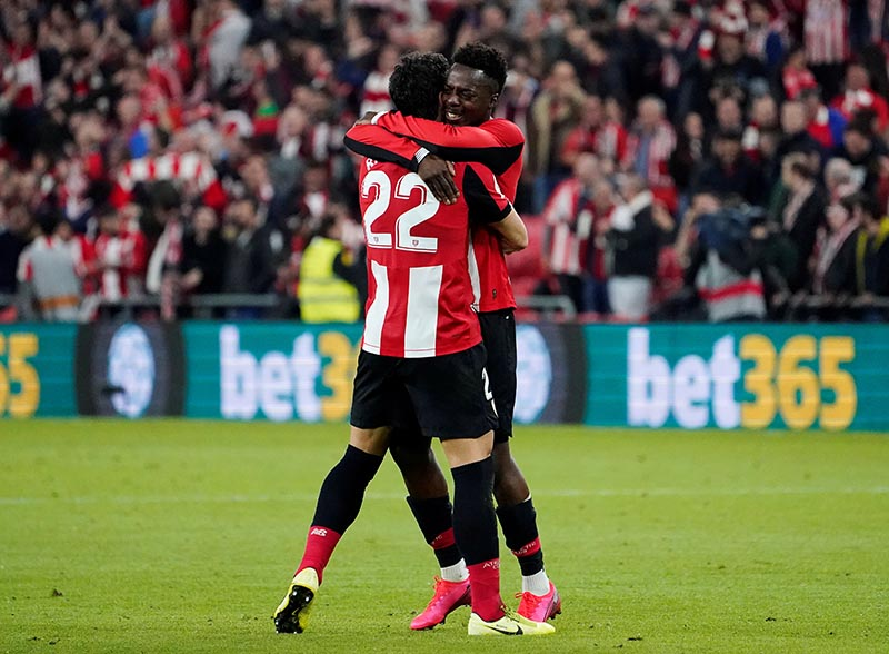 Athletic Bilbao's Inaki Williams and Raul Garcia celebrate after the match during the Copa del Rey match between Athletic Bilbao and FC Barcelona, at  San Mames, in Bilbao, Spain, on February 6, 2020. Photo: Reuters
