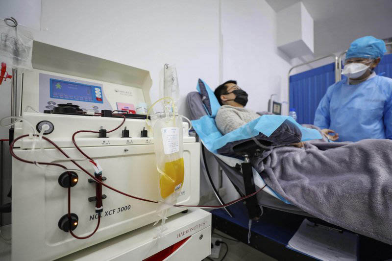 FILE - Dr. Kong Yuefeng, a recovered COVID-19 patient who has passed his 14-day quarantine, donates plasma in the city's blood center in Wuhan in central China's Hubei province, on Tuesday, February 18, 2020. Photo: AP