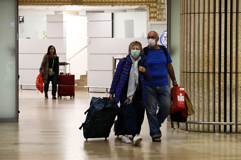 Passengers walk at the arrival area of a terminal at the Ben Gurion airport in Lod, near Tel Aviv, Israel, on February 22, 2020. Photo: Reuters