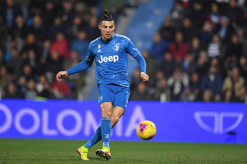 Juventus' Cristiano Ronaldo scores their first goal. Photo: Reuters