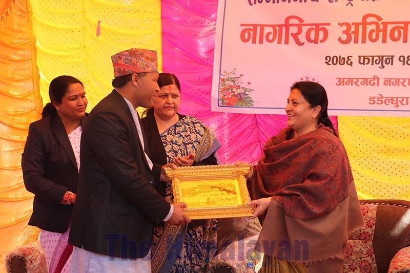 Dadeldhura District Coordination Committee Coordinator Ganesh Datta Bhatta felicitating President Bidya Devi Bhandari, in the district, on Friday, February 28, 2020. Photo: THT