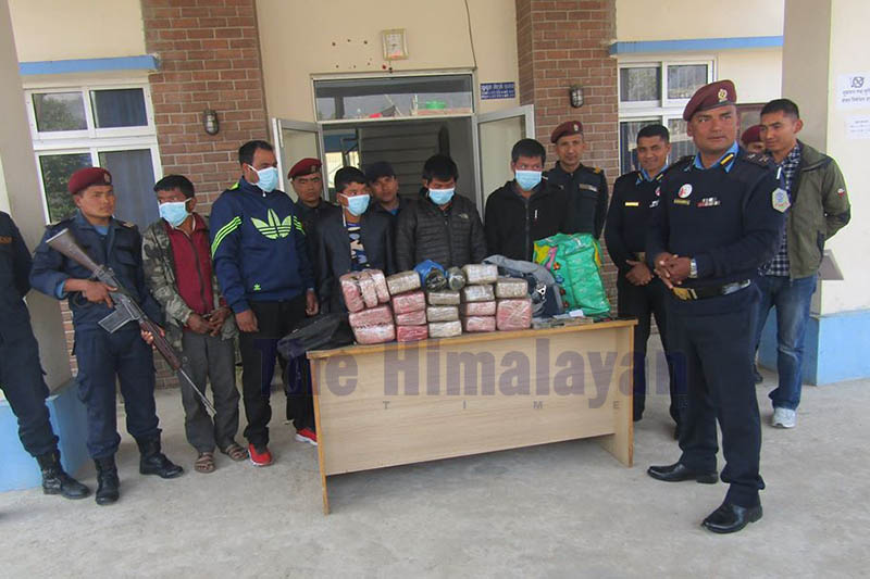 Police making public alleged drug smugglers along with seized illegal drugs at District Police Office, Dhading, on Monday, February 03, 2020. Photo: Keshav Adhikari/THT