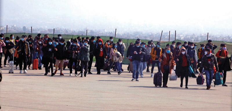 Domestic and foreign tourists wearing masks while proceeding towards the arrival section of Tribhuvan International Airport, on Friday. Photo: RSS