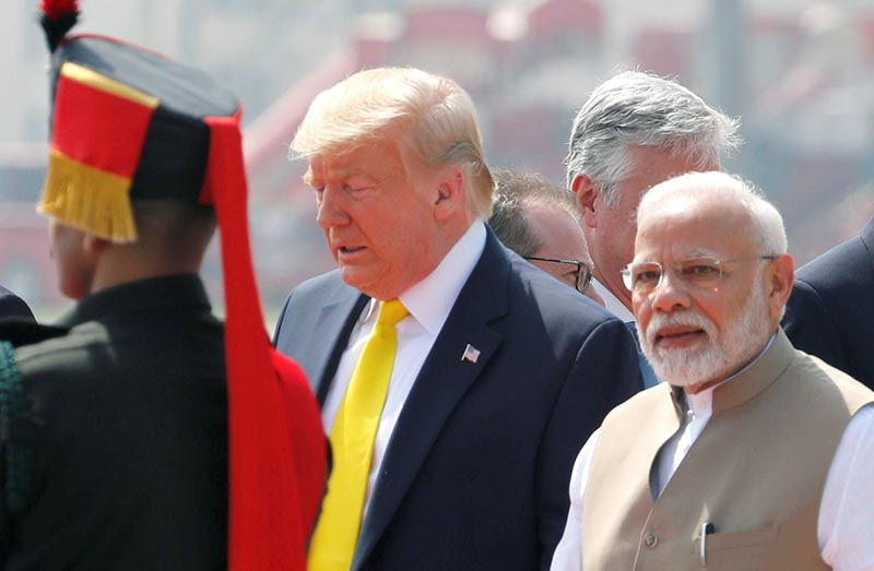 US President Donald Trump is welcomed by Indian Prime Minister Narendra Modi as he arrives at Sardar Vallabhbhai Patel International Airport in Ahmedabad, India, on Monday, February 24, 2020. Photo: Reuters