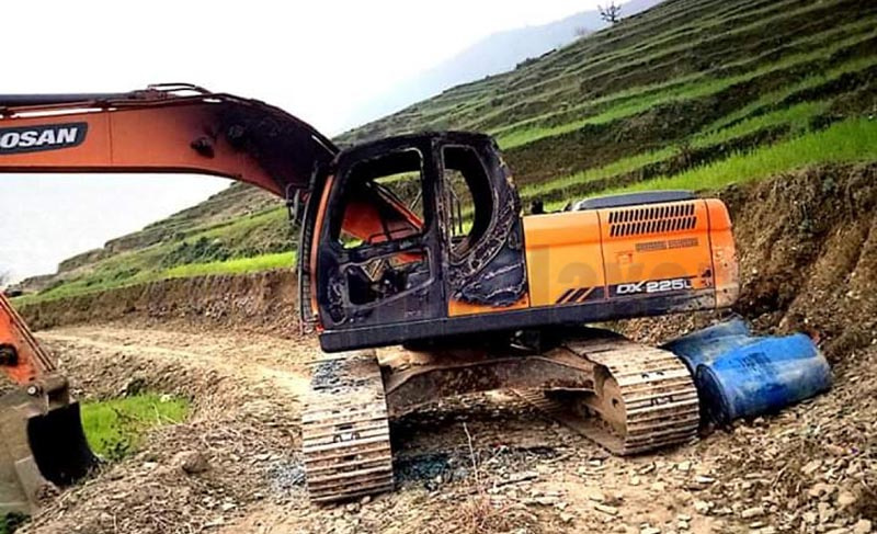 The damaged excavator that was set ablaze by an unidentified group in Chhapali of Sayal Rural Municipality-1, in Doti district, as pictured on Thursday, February 20, 2020. Photo: Tekendra Deuba/ THT