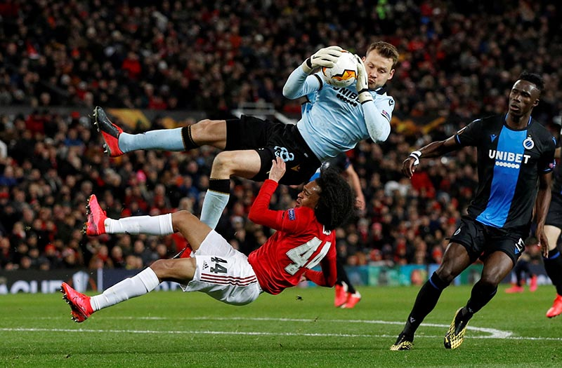 Club Brugge's Simon Mignolet in action with Manchester United's Tahith Chong during the Europa League Round of 32 Second Leg match between Manchester United and Club Brugge, at Old Trafford, in Manchester, Britain, on February 27, 2020. Photo: Reuters