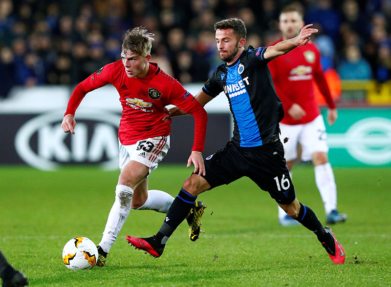 Manchester United's Brandon Williams in action with Club Brugge's Siebe Schrijvers during the Europa League - Round of 32 First Leg match between Club Brugge and Manchester United, at Jan Breydel Stadium, in Bruges, Belgium, on February 20, 2020. Photo: Reuters