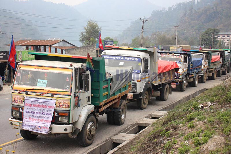 Tippers loaded with sand lining up on the road to head towards Gautam Buddha Cricket Stadium being constructed by Dhurmus Suntali Foundation, in Chitwan, on Saturday. Dhandingu2019s Galchhi Rural Municipality has donated 100 tippers of sand to the foundation for construction of the stadium. Photo: THT