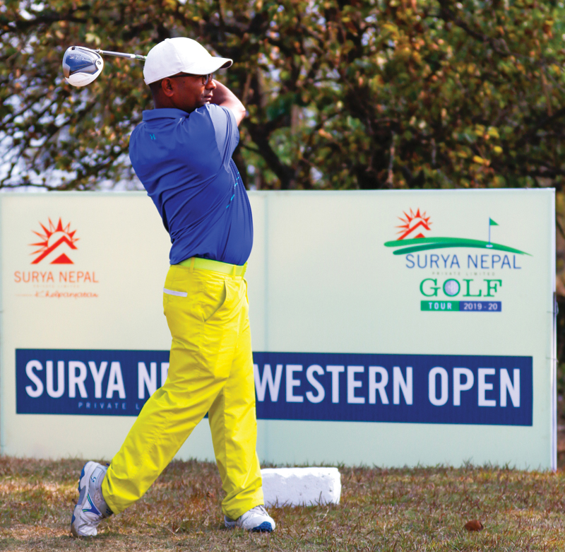 Dhana Bahadur Thapa plays a shot during the second round of the Surya Nepal Western Open at the Himalayan Golf Course in Pokhara on Thursday. Photo Courtesy: NPGA