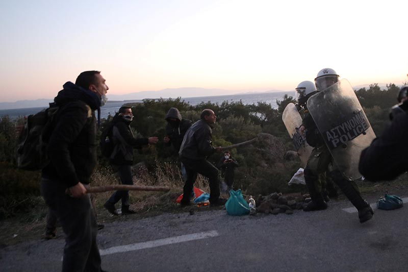 Locals scuffle with riot police at the area where the government plans to build a new closed migrant detention centre scuffle, in Karava on the island of Lesbos, Greece, February 25, 2020. Photo: Reuters