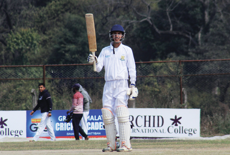 Bipin Acharya of KCTC raises his bat after completing half century against Baluwatar Cricket Club during the Orchid College second Himalaya Cricket League at the Mulpani grounds in Kathmandu on Sunday. Photo: THT