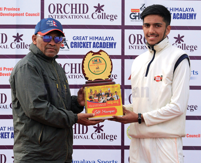 Sachin Sharma of Oasis receiving the man-of-the-match trophy from national team coach Jagat Tamatta (left) after the second Himalaya Cricket League match against Baluwatar in Kathmandu on Thursday. Photo: THT
