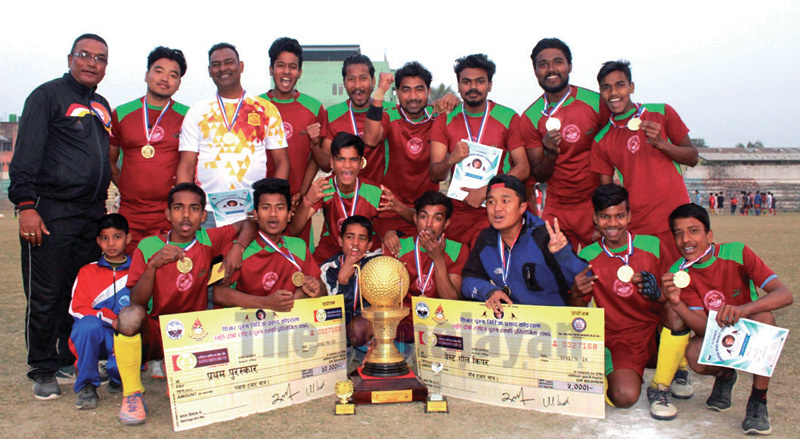 Province-5 players and officials celebrate with the trophy after winning the Girija Prasad Koiral Memorial National Hockey Tournament at the Sahid Rangashala in Biratnagar on Friday. Photo: THT