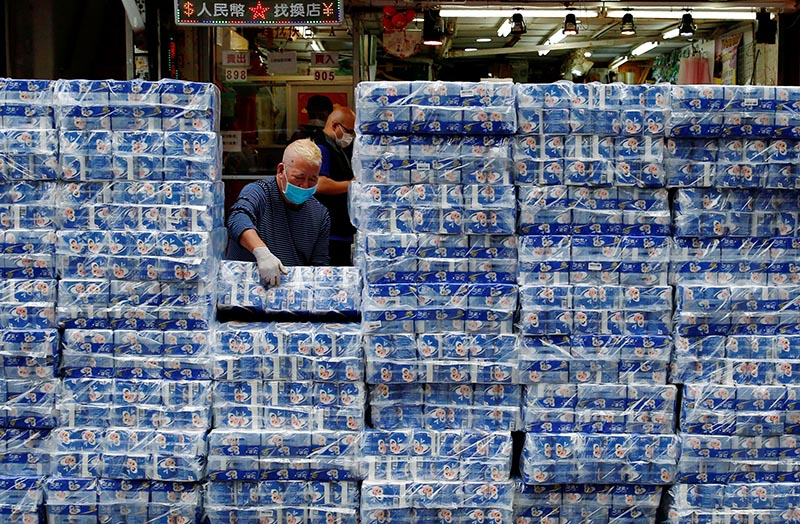 An employee restocks rolls of toilet paper at a market, following the outbreak of the novel coronavirus, in Hong Kong, China, on February 8, 2020. Photo: Reuters
