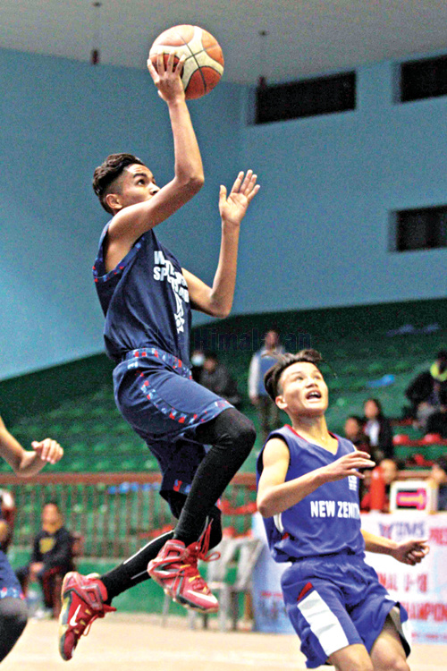Suraj Khatri of White House College jumps to score against New Zenith College in semi-final match during the fifth IIMS U-18 National Basketball Tournament at NSC covered hall, Tripureshwor in Kathmandu on Tuesday. Photo: Udipt Singh Chhetry/THT