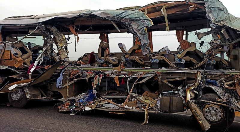 The remains of a Kerala state-run bus that collided head-on with a truck near Avanashi, Tamil Nadu state, India, Thursday, Feb 20, 2020. Photo: AP