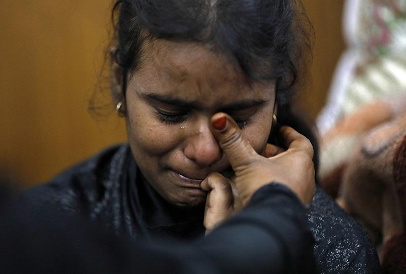 A Muslim girl is consoled in a shelter camp after she and her family fled their home following clashes between people demonstrating for and against a new citizenship law in a riot affected area in New Delhi, India, February 28, 2020. Photo: Reuters