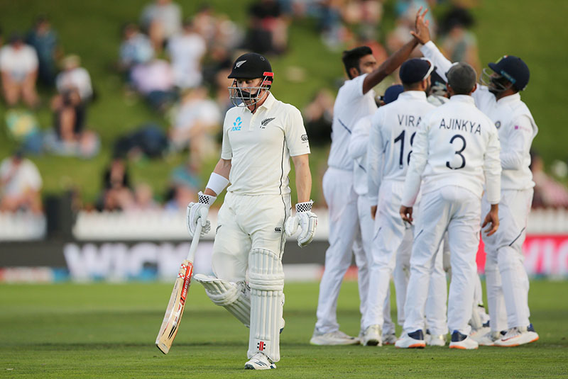 New Zealand's Henry Nicholls walks off dejected after losing his wicket. Photo: Reuters
