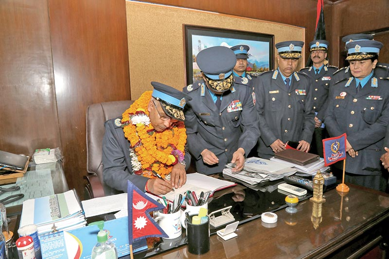 Newly-appointed Inspector General of Police Thakur Prasad Gywali assuming office at the police headquarters in Naxal, Kathmandu, on Wednesday. Photo: RSS