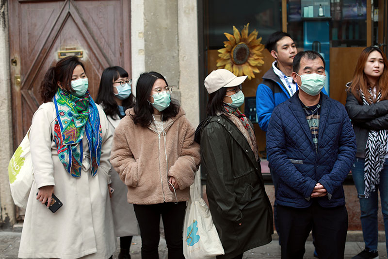 People wear protective masks at Venice Carnival, which the last two days of, as well as Sunday night's festivities, have been cancelled because of an outbreak of coronavirus, in Venice, Italy February 23, 2020. Photo: Reuters