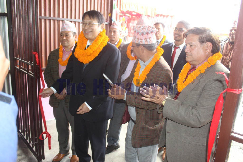 Japanese Ambassador to Nepal Saigo Masamichi (second from left) smiles as he cuts the ribbon to hand over the oxygen plant to Dhankuta District Hospital, in Sunsari, on Thursday, February 27, 2020. Photo: Khagendra Prasad Ghimire/THT