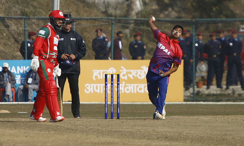Karan KC bowling in the opening match of ICC World Cup Cricket League Two  held in TU Cricket Stadium, in Kirtipur, on Wednesday. Photo: RSS