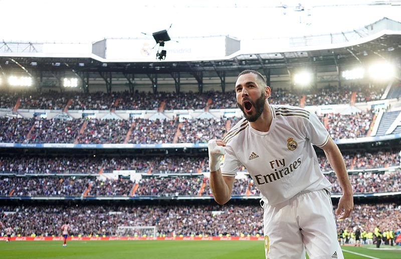 Real Madrid's Karim Benzema celebrates scoring their first goal during the La Liga Santander match between Real Madrid and Atletico Madrid, at Santiago Bernabeu, in Madrid, Spain, at February 1, 2020. Photo: Reuters