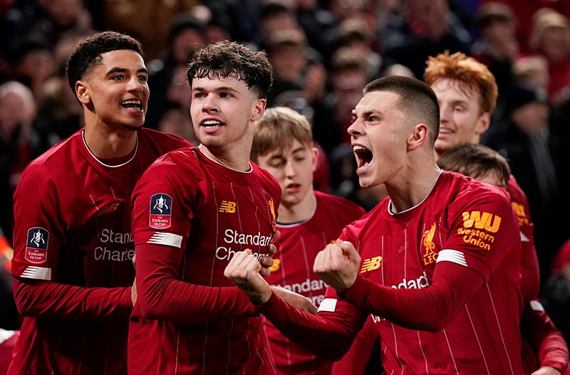Liverpool's Neco Williams celebrates with team mates after Shrewsbury Town's Ro-Shaun Williams scored an own goal and the first for Liverpool during the FA Cup Fourth Round Replay match at Anfield, in Liverpool, Britain, on February 4, 2020. Photo: Reuters