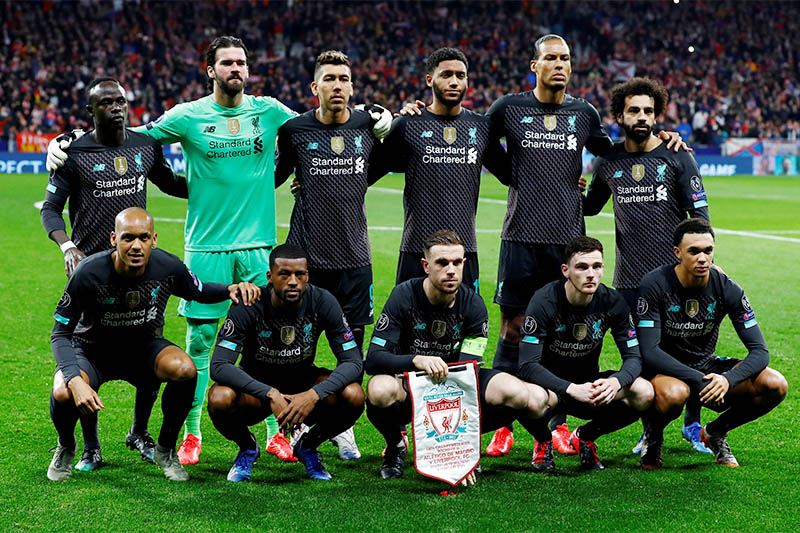 FILE PHOTO: Liverpool players pose for a team group photo before the match. Photo: Reuters