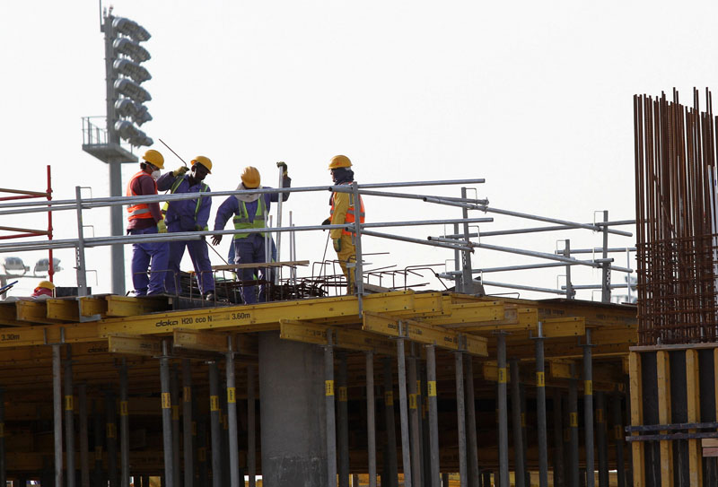 Migrant labourers work at a construction site at Aspire Zone in Doha, Qatar, March 26, 2016. Workers in Qatar renovating a 2022 World Cup stadium have suffered human rights abuses two years after the tournament's organisers drafted worker welfare standards in the wake of criticism, Amnesty International said. Photo: Reuters