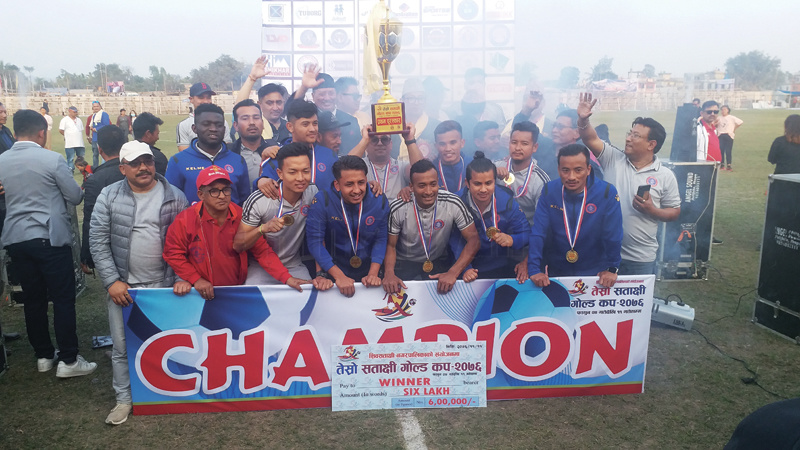 Players and officials of San Miguel Machhindra Club celebrating with the trophy after winning the Satakshi Gold Cup at the Ganeshman Singh Educational Foundation grounds in Jhiljhile, Jhapa on Sunday. Photo: THT