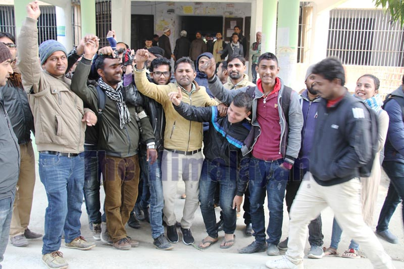 Students at Mahendra Bindeshwori Multiple Campus chanting slogans to resume teaching-learning activities that were halted due to protest of part-time teachers, in Rajbiraj, on Monday. Photo: THT