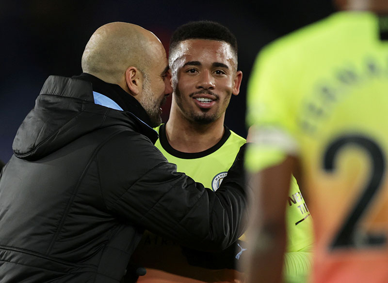 Manchester City manager Pep Guardiola celebrates after the match with Gabriel Jesus during the Premier League match betweeen Leicester City and Manchester City, at King Power Stadium, in Leicester, Britain, on February 22, 2020. Photo: Reuters