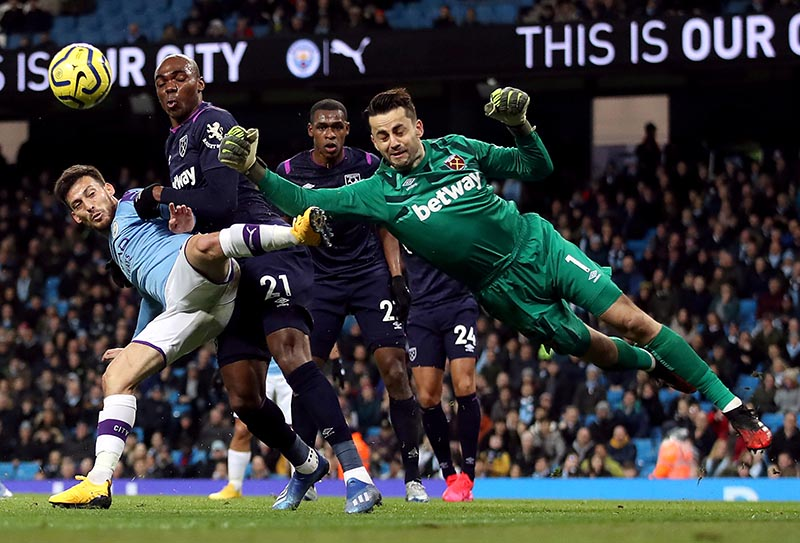 West Ham United's Lukasz Fabianski and Angelo Ogbonna in action with Manchester City's David Silva during the Premier League between Manchester City and West Ham United, at Etihad Stadium, in Manchester, Britain, on February 19, 2020. Photo: Action Images via Reuters