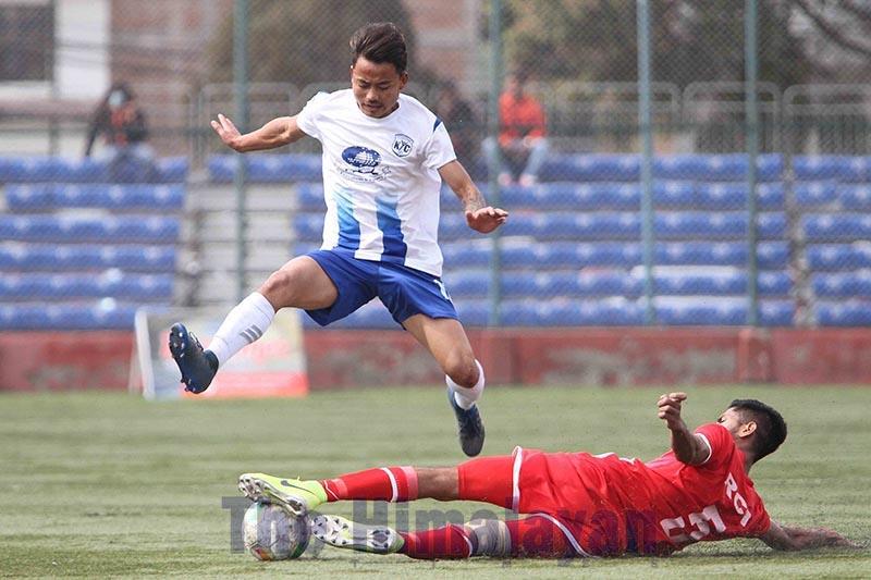 Khumaltaru2019s Mahesh Rai (top) and RCTu2019s Lokedra Bahadur Karki vie for the ball during their Martyrs Memorial B Division League match in Lalitpur on Friday. Photo: Udipt Singh Chhetry/THT