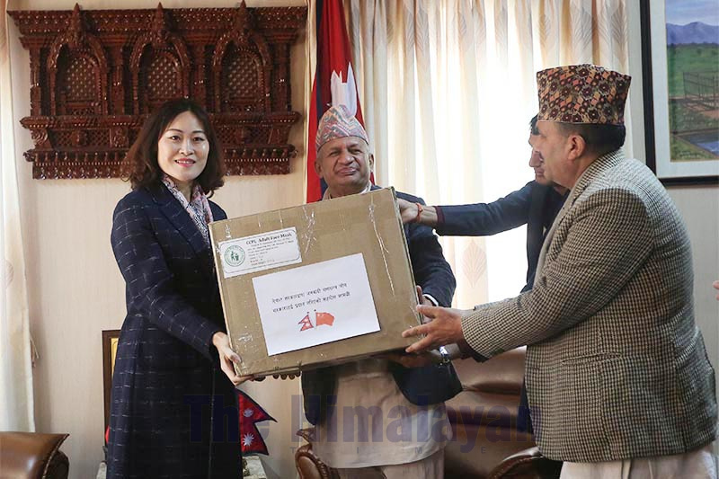 Minister of Foreign Affairs Pradeep Gyawali (centre) and Minister of Health Bhanubhakta Dhakal (right) handing over a box of surgical masks to Chinese Ambassador to Nepal Hou Yanqi, in Kathmandu, on Friday, February 7, 2020. Photo: THT