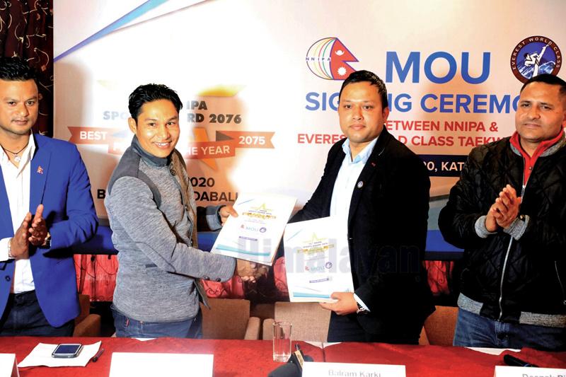 President Deepak Shrestha (left) exchanges MoU with Nepal Chapter Vice-president of Everest World Class Taekwondo America, Balram Karki in Kathmandu on Friday. Photo: THT