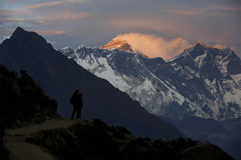 FILE PHOTO: Light illuminates Mount Everest (C) during sunset in Solukhumbu district, also known as the Everest region, in this picture taken November 30, 2015. Photo: Reuters