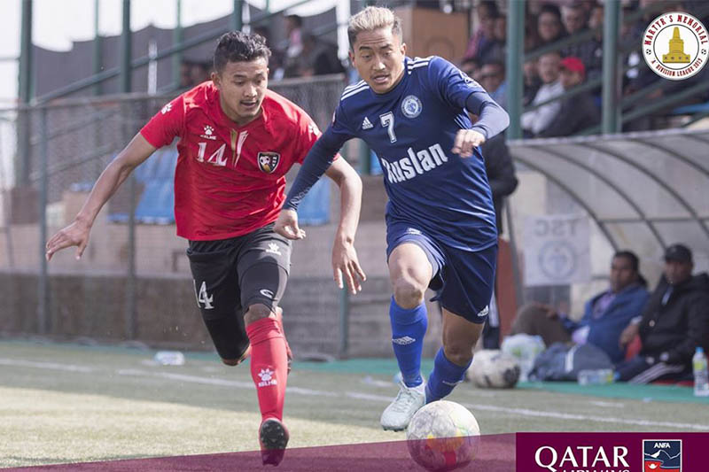 New Road Team player (red jersey) vies for a ball with Ruslan Three Star Club player during the ongoing Qatar Airways Martyr's Memorial 'A' Division League in Lalitpur, on Tuesday, February 11, 2020. Courtesy: ANFA/Facebook