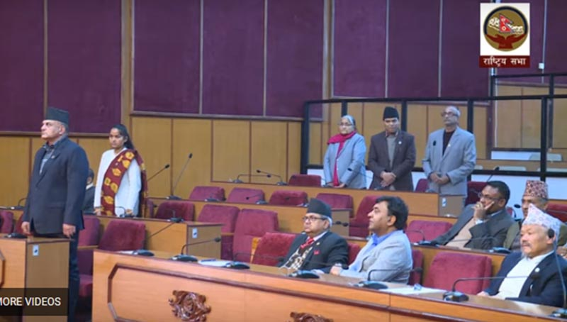 Lawmaker representing the main opposition obstructs the proceedings of the National Assembly meeting, in Kathmandu, on Thursday, DFebruary 20, 2020. Image: Screenshot of NA live broadcast/Youtube
