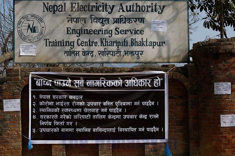 Locals have put a banner outside Nepal Electricity Authority Training Centre that has been vacated for quarantining Nepalis returning from Chinau2019s Hubei province, in Bhaktapur, on Sunday, February 09, 2020. Photo: Skanda Gautam/THT
