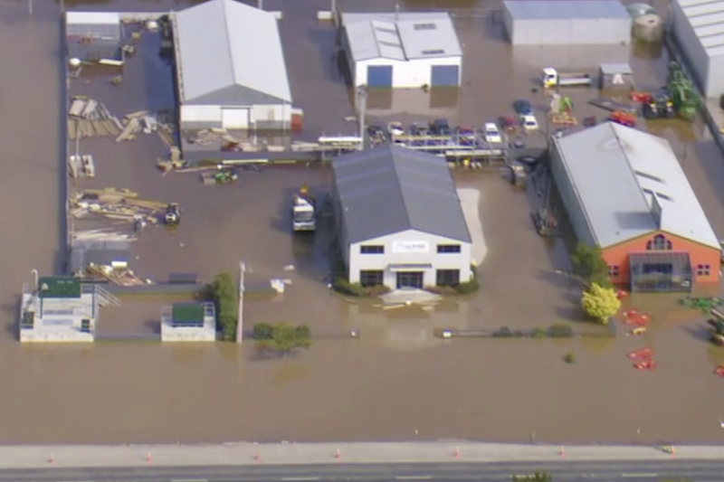 In this image made from video, buildings are submerged in floodwaters in Gore, New Zealand, Wednesday, Feb 5, 2020. Photo: Newshub via AP