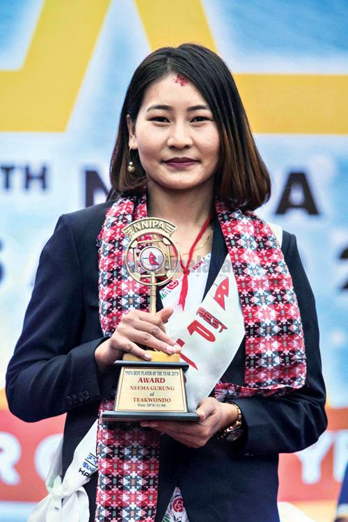 Nima Gurung of Taekwondo winner of the best player of the year 2075 with trophy and cash prize during the 14th NNIPA Sports Award Ceremony 2076 at Basantpur Dabali, Kathmandu Durbar Sqaure in Kathmandu on Tuesday. Photo: Udipt Singh Chhetry/THT