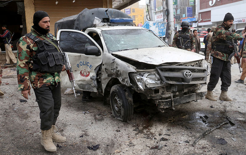 Police officers guard a damaged vehicle at the site of a bomb blast in Quetta, Pakistan February 17, 2020. Photo: Reuters